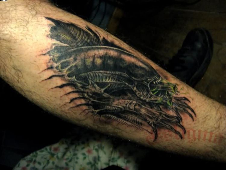 Extremely Grey Color Ink Terrifying Ripped Skin Alien Tattoo On Boy's Arm