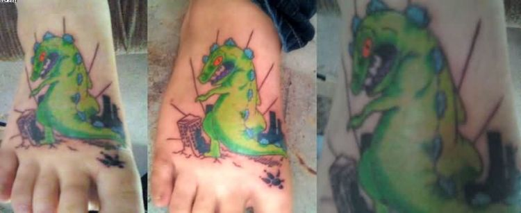 Fabulous Green And Blue Color Ink Dragon Animated Tattoo On Foot For Girls