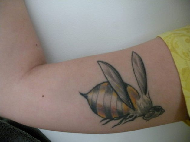 Famous Black And Yellow Color Ink Muscles Bumblebee Tattoo Design On Arm For Girls