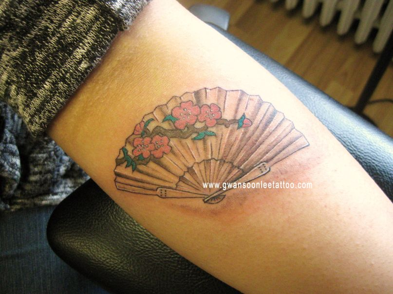 Fantastic Red And Green Color Ink Asian Fan Tattoo Design On Arm For Girls