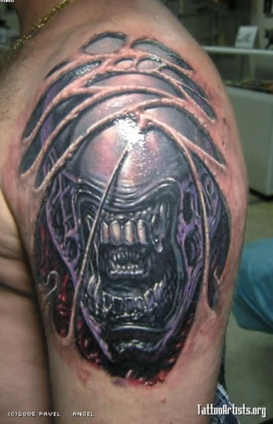 Fantastic Red Blue And Grey Color Ink Evil & Scary Alien Tattoo Design For Men On Boy Shoulder