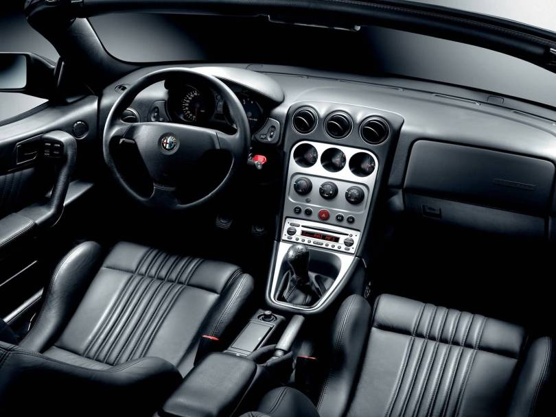 Front inside of black colour Alfa Romeo Spyder Car