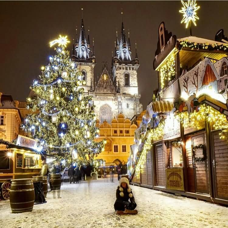 Full Town Enjoying Evening With Giant Christmas Tree
