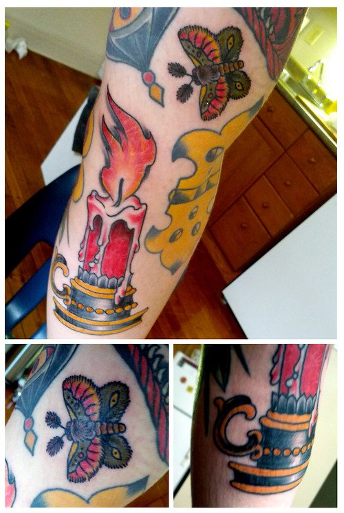 Great Yellow Blue Black And Red Color Ink Burning Candle With Butterfly Tattoo Design On Arm For Girls