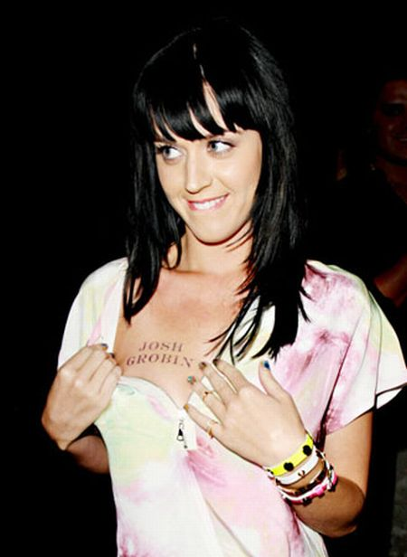 Groovy Grey Color Ink Celebrity Showing Tattoo On Chest For Girls