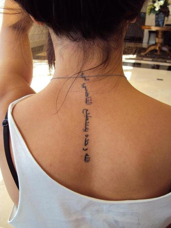 Horrible Black Color Ink Arabic Tattoo On Girl's Upper Back For Girls