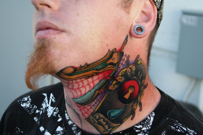 Horrible Green Blue Black And Red Color Ink Spider Coffin Tattoo On Neck For Boys