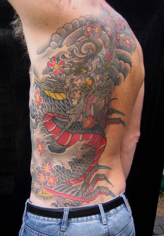 Impressive Black And Red Color Ink Asian Dragon Tattoo On Back For Boys Made By Expert