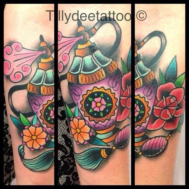 Incredible Black Blue Red And Green Color Ink Beautiful Perfume Bottle Tattoo With Flowers On Leg For Girls