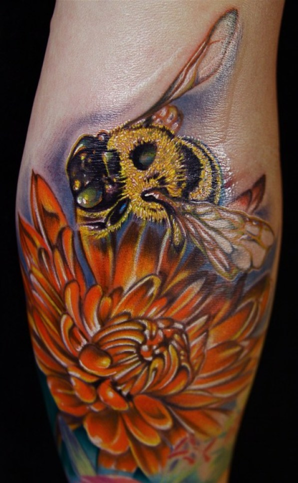 Incredible Red Blue Black And Yellow Color Ink Bumblebee Tattoo On Flowers On Arm For Girls