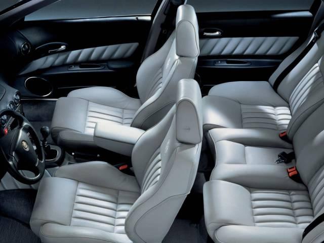 Inner side of white seat Alfa Romeo 166 Car