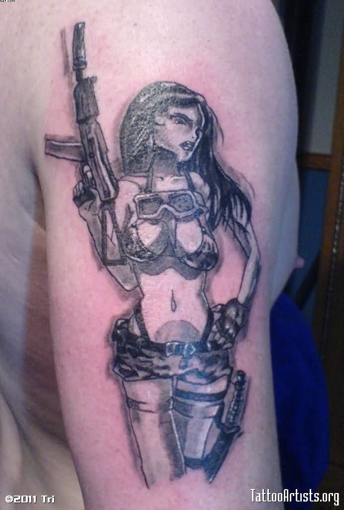Innovative Black Color Ink Army Girl Holding Gun Tattoo Design On Shoulder For Boys
