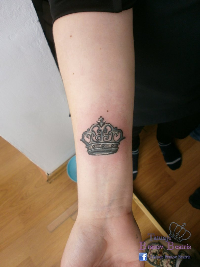 Latest Black Color Ink Small Crown Tattoo Near Wrist For Girls
