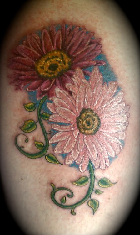 Latest Blue Green Red And Black Color Ink Gerbera Daisy Tattoo Design For Girls