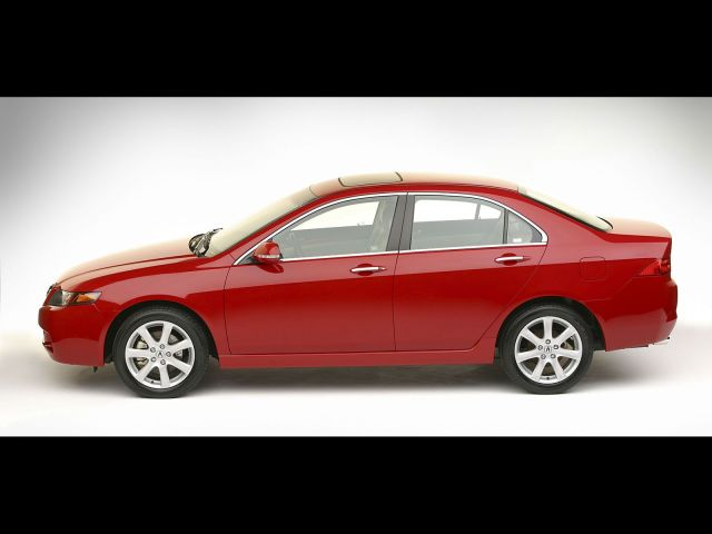 Left side of beautiful red Acura TSX car