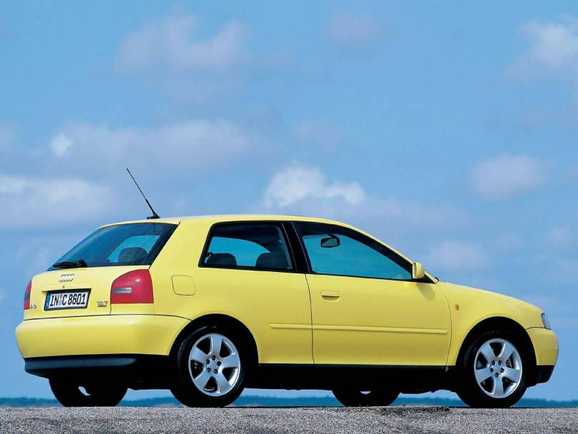 Left side view of beautiful yellow Audi A3 car