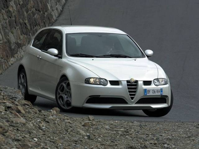 Left turn on the road of White colour Alfa Romeo 147 GTA Car