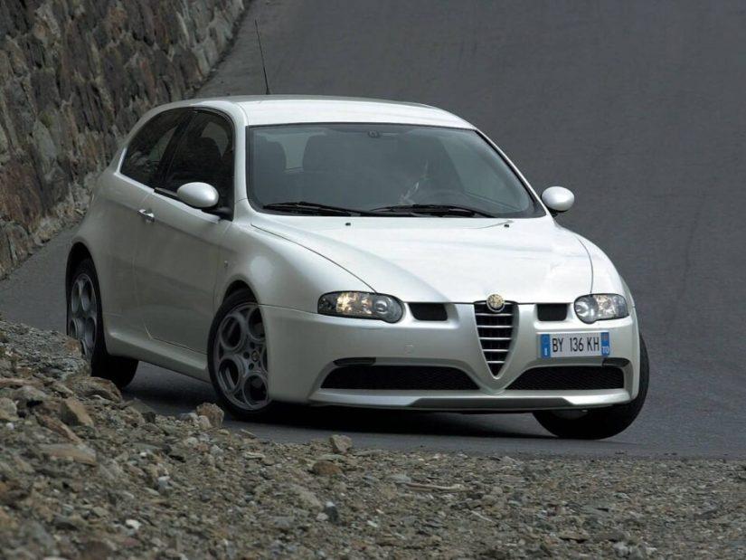Left turn on the road of White colour Alfa Romeo 147 GTA Car