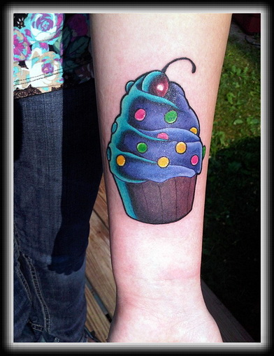 Lovely Black And Blue Color Ink Cherry Cake Tattoo Image On ARm For Girls