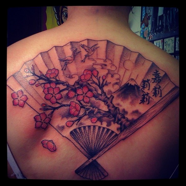 Maori Black And Red Color Ink Asian Fan Tattoo Designs On Upper Back For Girls