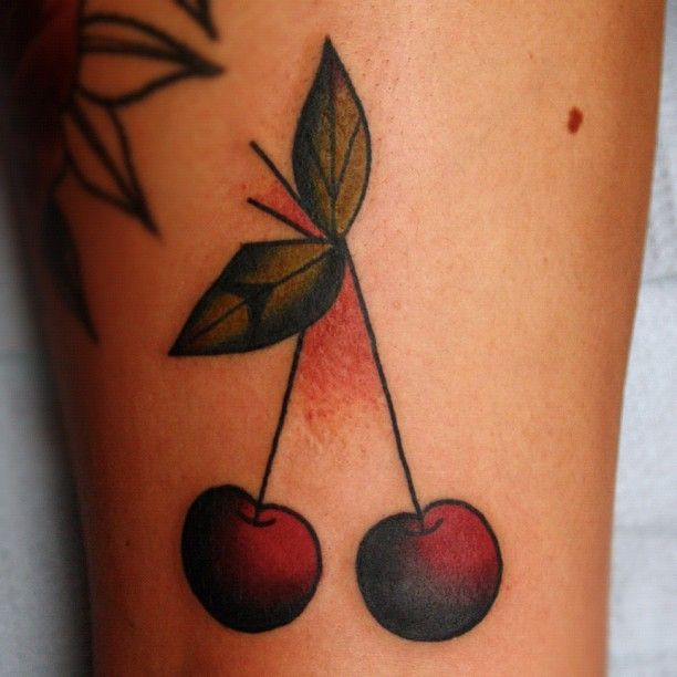 Maori Black And Red Color Ink Cherry Tattoo On Leg For Girls