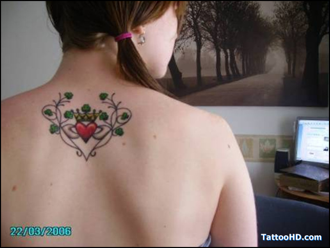 Marvel Green Red And Black Color Ink Claddagh Tattoo On Upper Back For Women