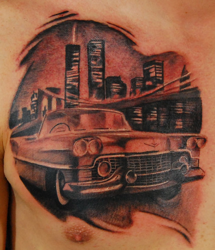 Mind Blowing Black And Red Color Ink Town Car Tattoo On Chest For Boys