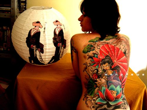 Mind Blowing Black Red And Green Color Ink Asian Tattoo On Girl's Back For Girls