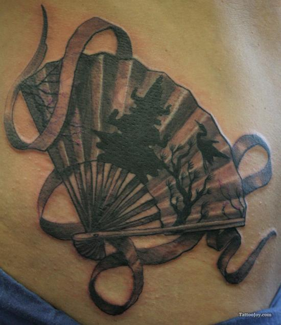 Most Beautiful Black Color Ink Asian Fan Tattoo Design On Ribs For Girls