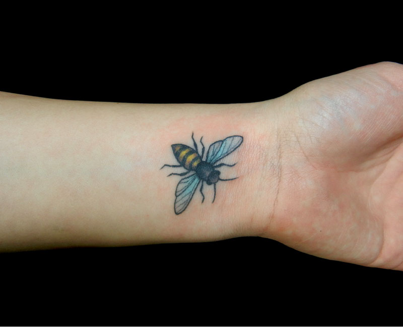 Most Beautiful Blue Black And Yellow Color Ink Bumblebee Tattoo On Wrist For Girls