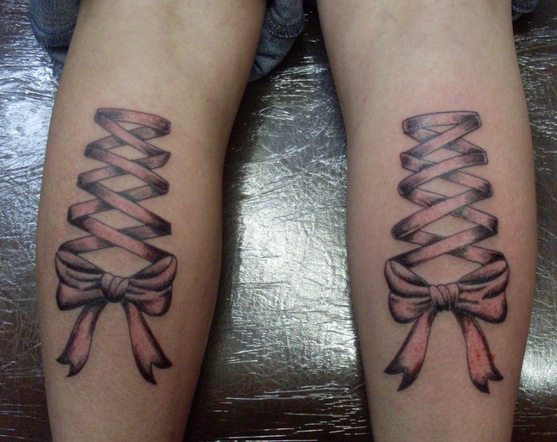 Motivational Black And Red Color Ink Corset Tattoo On Back Legs For Girls