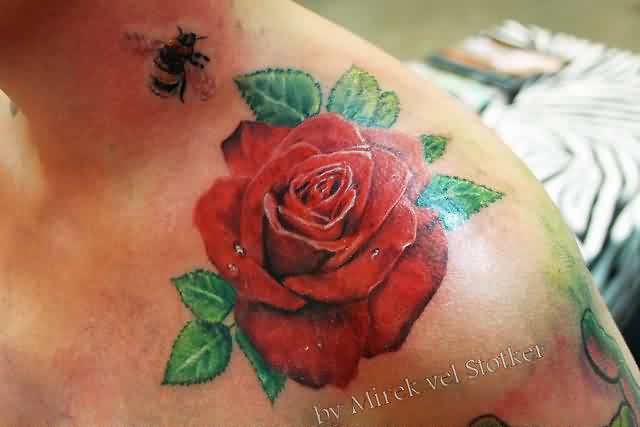 Nice Black Green And Red Color Ink Bee & Rose Tattoo For Boys On Shoulder