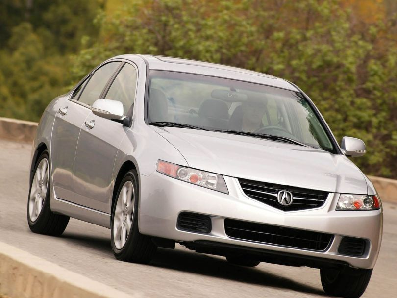 On the road beautiful silver Acura TSX car
