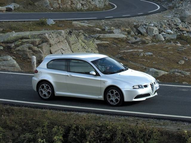 On the road of beautiful White colour Alfa Romeo 147 GTA Car