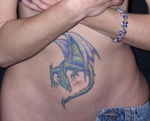 Out Standing Blue And Green Color Ink Dragon Belly Tattoo For Girls