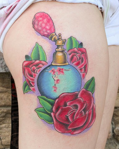Out Standing Blue And Red Color Ink Perfume Bottle With Flower Tattoos On Thigh For Girls