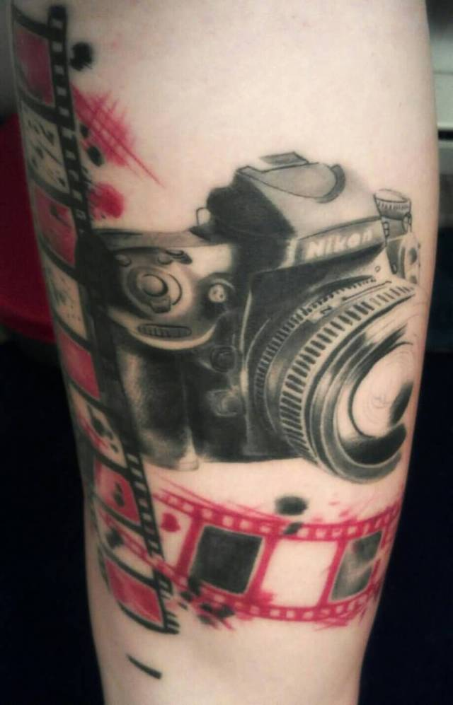 Passionate Black And Red Color Ink Nikon Camera Tattoo With Film For Girls On Arm