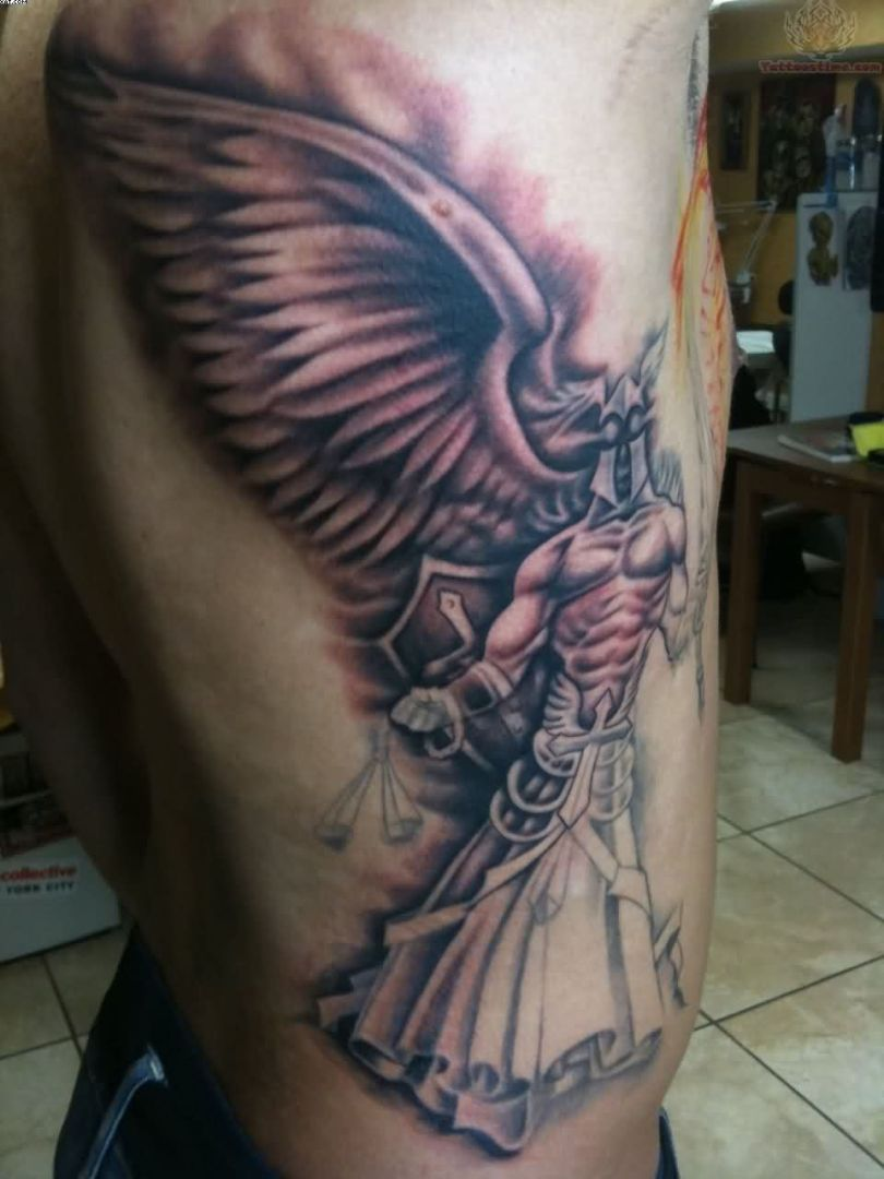 Passionate Red Light And Grey Color Ink Justice Winged Angel Tattoo Design On Ribs For Boys