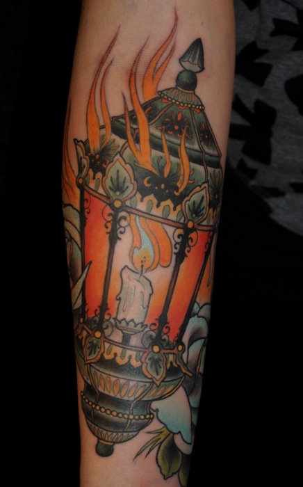Perfect Blue Black And Red Color Ink Flaming Candle Lamp Tattoo Design On Arm For Boys
