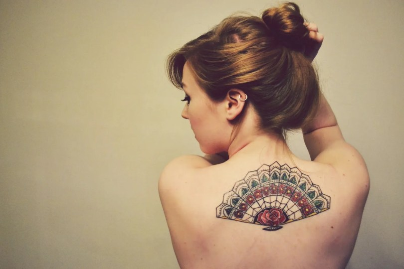 Perfect Red Green And Black Color Ink Asian Fan Tattoo On Upper Back For Girls