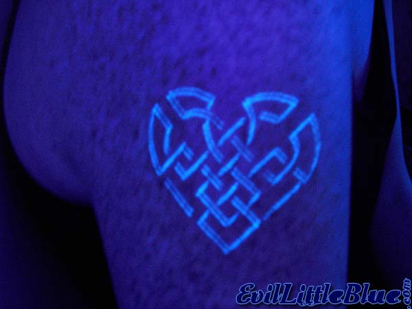 Popular Blue Color Blacklight Celtic Heart Tattoo Design On Shoulder For Boys