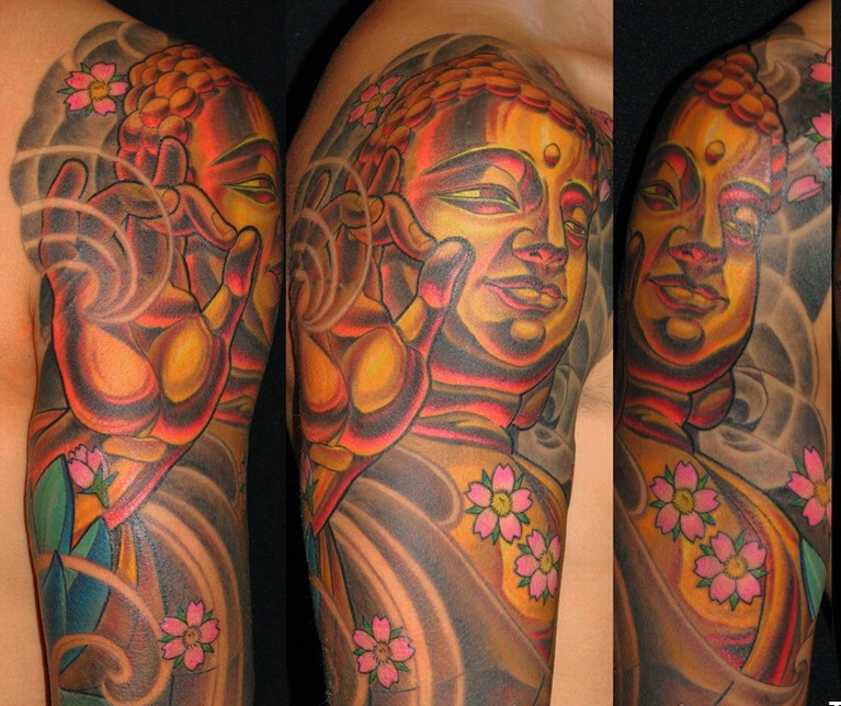 Realistic Yellow Green Black And Red Color Ink Half Sleeve Buddhist Tattoo Design On Shoulder For Boys