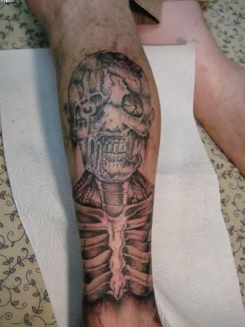 Sad Skeleton Zombie Tattoo On Leg With Black Ink