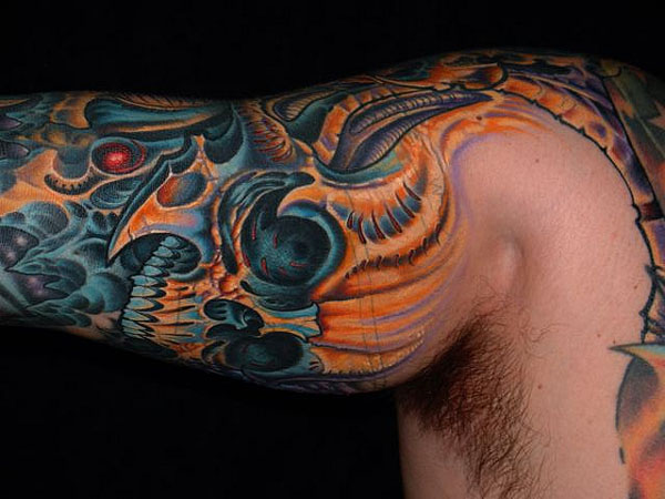 Sensation Black Blue And Yellow Color Ink Biomechanical Skull Tattoo On Muscles For Man