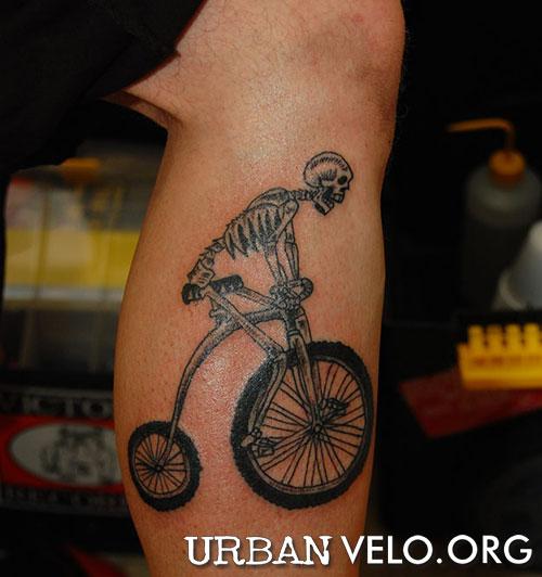 Sensation Black Color Ink Skeleton Cycle Tattoo On Leg For Boys