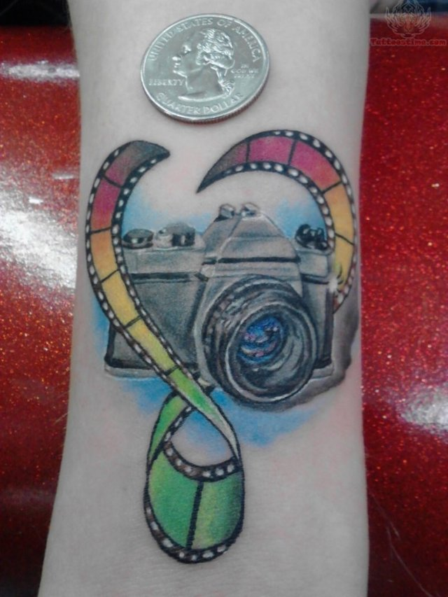 Sensation Blue Green Black And Red Color Ink Camera Tattoo On Arm For Girls