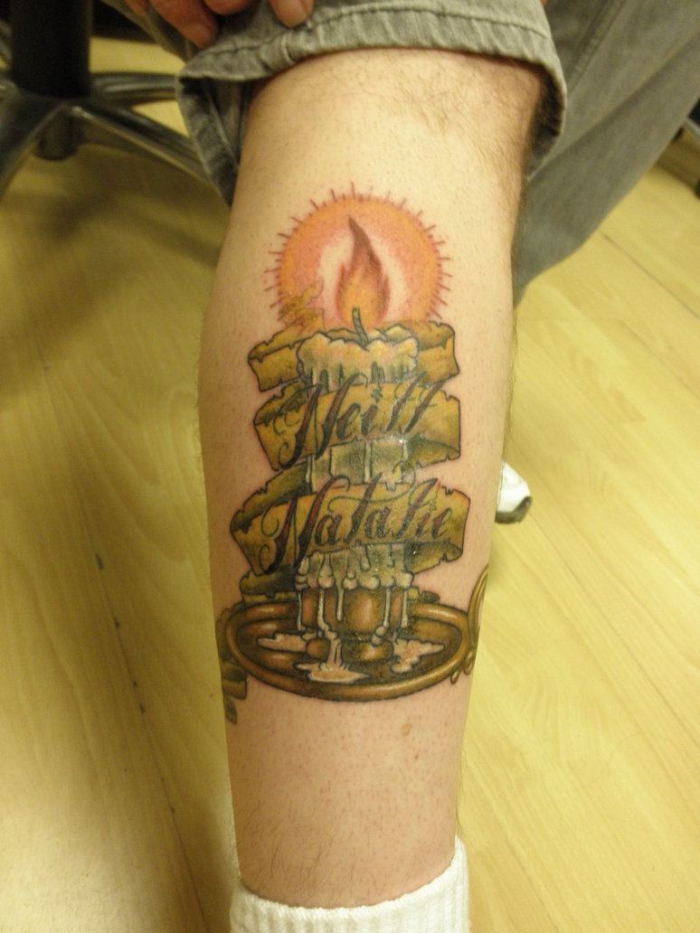 Sensation Green And Red Color Ink Burning Candle With Banner Tattoo Design On Leg For Boys