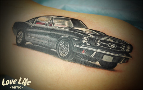 Stunning Black And Red Color Ink Car Tattoo Design On Shoulder For Boys