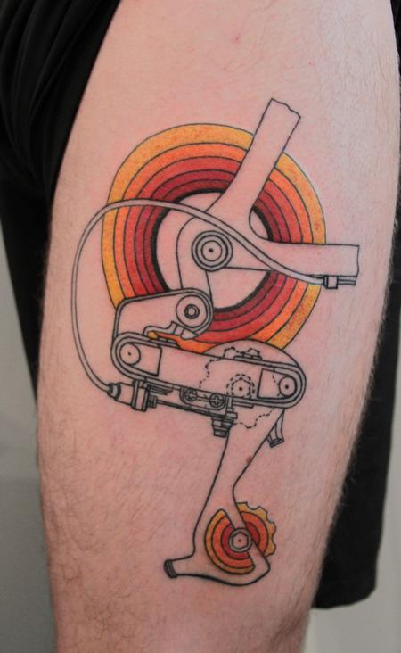 Stunning Yellow Black And Red Color Ink Cycle Gear Tattoo On Biceps For Boys