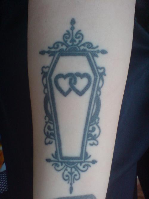Superb Black Color Ink Hearts Coffin Tattoo Design For Girls